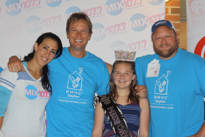 "Morning show hosts Jeff, Gina and Dave at MIX 107.7's Radiothon smiling and posing with ""Miss Ohio"" from Pure American Pageant Junior-Miss"