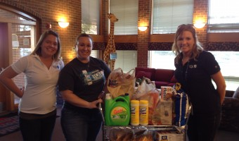 Volunteers with Donated Goods