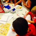 Children coloring at table during Red Shoe Event
