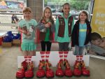 Girl scouts with their pull tab collections