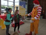 Ronald McDonald with girl scouts