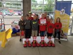 Children posing for a picture at Tab-a-PULL-ooza