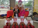 Ronald McDonald posing with two girls