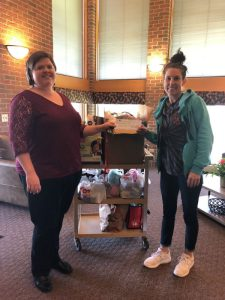 Family Room Program Director Julie Arias  Melissa dropping off hygiene items for families