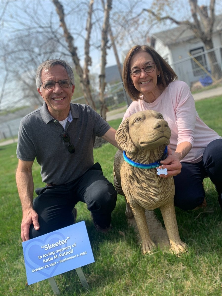 Curt and Bev Puthoff with Skeeter Statue